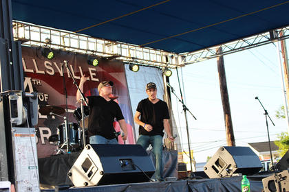 """Kenny Agee, left, and Hunter Yates, both of Campbellsville, sing to Luke Bryan's hit """"Country Girl."""""""