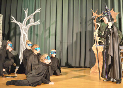 Andie Woodcox, portraying Maleficent, directs her goons to find Sleeping Beauty.