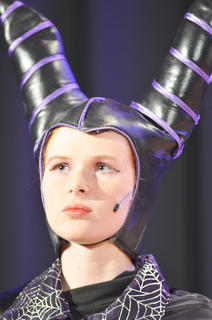 Andie Woodcox portrays Maleficent, who casts a spell on Sleeping Beauty.