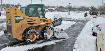 A Campbellsville University parking lot is being scraped on Thursday afternoon.