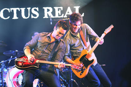 "Sanctus Real guitarists Seth Huff, left, and Chris Rohman perform as part of the ""Hands of God"" tour at Living Grace Church in Campbellsville Friday night."