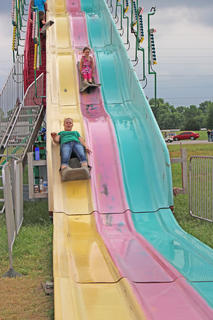 June Wiggins, left, and Kayley Benningfield race each other down the Super Slide.