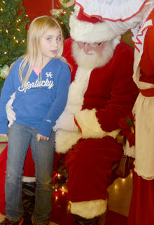 Alexis Ellsworth, a kindergartener at TCES, tells Santa and Mrs. Claus what she wants for Christmas this year.
