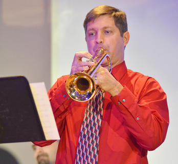 "Dr. Reese Land, associate professor of trumpet, performs a jazz version of ""Twelve Days of Christmas."""