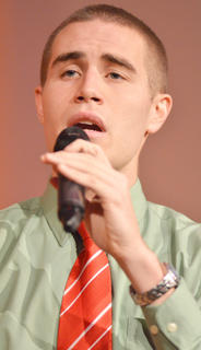 "Campbellsville Singers member Blake Herron of Campbellsville performs ""I'll Be Home for Christmas/Auld Lang Syne."""