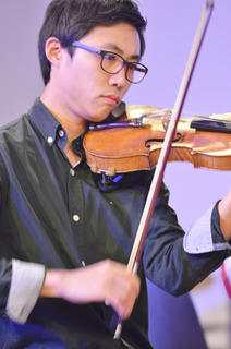 "University Orchestra member Zhihuan An of Shanghai, China performs ""Celebrate the Christ."""