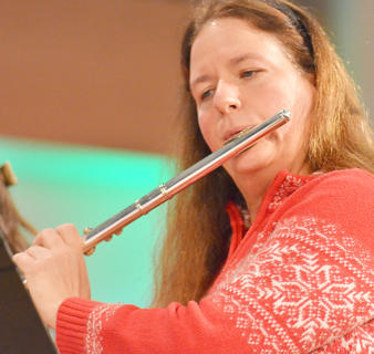 "Dr. Lisa McArthur, professor of music, performs ""Christmas Morning (A Carol and Joyful Moment)"" with a flute ensemble."