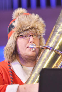 "Tuba ensemble member Jeff Cloyd of Tompkinsville performs ""Rudolph the Red-Nosed Reindeer."""