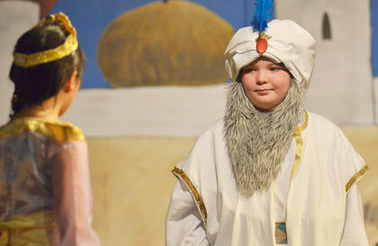 The Sultan, portrayed by TCES student George Prebee, explains to his daughter, Princess Jasmine, played by Jadyn Bell, that she must choose a husband or one will be chosen for her.