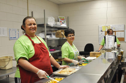 Taylor County Elementary School cafeteria workers Sherry Henderson, left, and Loretta Willis wait for the lunch rush.