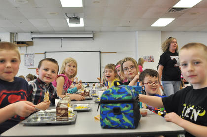 From left, TCES students Cameron Burton, Jacob Johnson, Isabelle Hoover, Emilee Gabehart, Savannah Milby, Zann Harris, Elijah Rogers and Zack Hancock enjoy their lunch.