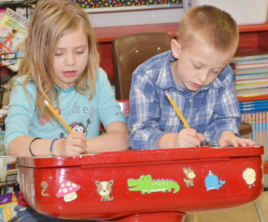 At Taylor County Elementary School, students in Shana Crabtree and Gail McQueary's second grade classroom wrote last Thursday morning about what they believe Santa is doing now, since his busiest time of the year is over. Pictured are Alysia Justice and Zander Smith.