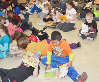 "Students in Karen Bruce and Robin Graham's second-grade classes at Taylor County Elementary School sing and dance to ""Gotta Keep Reading,"" last Thursday morning, which they will perform for the TCES student body this week."