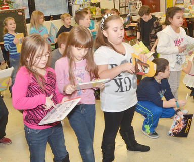 "From left, TCES second-grade students Jasmine Hayden, Ayshia Edwards, Darlene Ferguson, Dawson Creason and Alayna Venegas sing ""Gotta Keep Reading."""