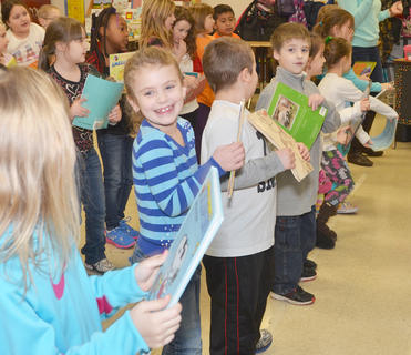 "Though their back-to-school day was cut short because of winter weather, local students headed back to the classroom last Thursday after their winter break. School was dismissed on Friday and Monday for winter weather. Above, TCES second-grade student Versailee Butler smiles as she sings ""Gotta Keep Reading"" with her classmates."