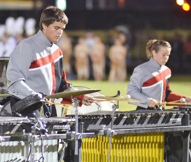 Nine area bands competed at Taylor County High School's annual marching band invitational on Saturday, Sept. 21. Campbellsville High School came in second place in preliminary competition in Class A and eighth place overall. Garrard County took home grand champion honors. TCHS and Campbellsville University marching bands performed in exhibition. Above, Hunter Cowherd, at left, and Alexi Buis play with the TCHS band.