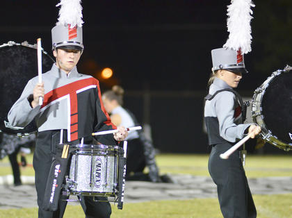 Alex Parker plays snare drum, at left, and Gabby Doerr plays bass drum for the TCHS drumline.