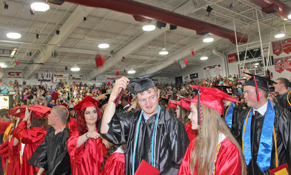 Taylor County's Class of 2015 shows its enthusiasm as students toss their graduation caps into the air.