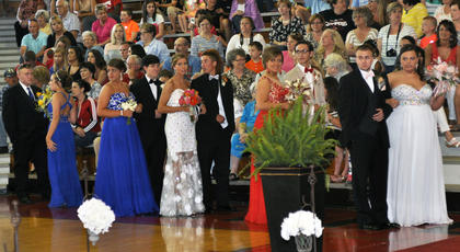 Dressed in shades of bright blue, white and red, TCHS students and their dates line up to walk down the prom runway.