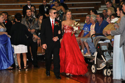 TCHS student Ryan Cox sports a pair of shades while escorting Makayla Simmons during prom walk-in.