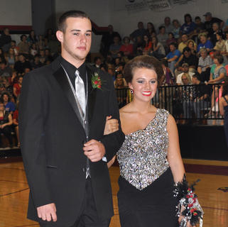 Donning classic shades of black and silver, TCHS students Rylee Beard and Weston Sullivan stop for a photo during prom walk-in.