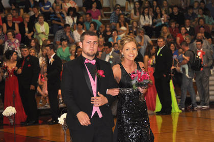 Chase Turner escorts a smiling Makayla Herron down the TCHS prom runway.