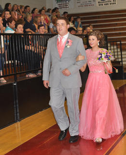 Hannah Shines and Dylan Thompson wear matching shades of pink for the TCHS prom.