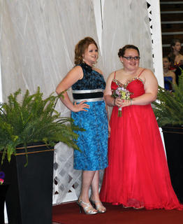 TCHS students Kalia Passmore, left, and Taylor Reynolds strike a pose for their official prom photo.