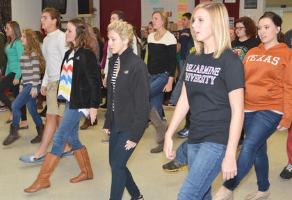 Show choir members sing and perform their choreography.