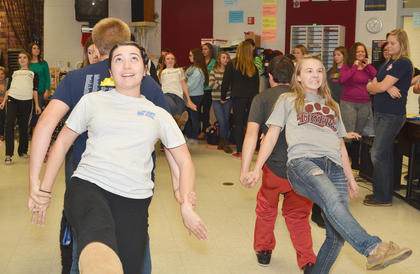 """Show choir members, from left, Rachel Hinton and Mitchell Tinnell and Hannah Brockman and Justice Gregory sing and dance to """"Aladdin."""""""