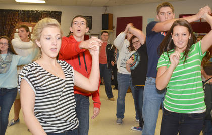 "From left, Maddie Tungate and Hunter Jessie and Brittany Speer and Grant Cox dance to a medley from ""Aladdin."""