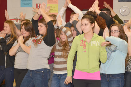 The female members of the show choir strike a pose at the end of a number.