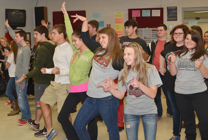 Show choir members strike a pose at the end of a song.