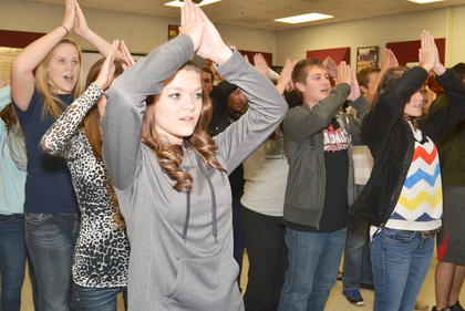 "Show choir members dance to music from ""Aladdin."""