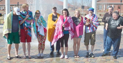 "Nine people participated in the first Tiger Plunge, which raised about $400 for CU organizations. From left are Dr. Michael Carter, CU's president; Dr. Jason Garrett, associate professor of communication; CU student Ye Wei ""Vicky""; Rob Roberts, CU's director of grounds and landscape development; students Ellie McKinley of Campbellsville and Shelby Mattingly of Versailles; Dr. John Hurtgen, dean of the CU School of Theology; Dr. Bob Wade, dean of the School of Nursing; and Stan McKinney, CU associate professor of journalism and lead professor for mass communication."