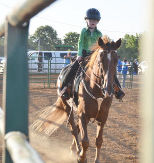 Harper Grider of Columbia participates in this year's Tommie Johns Memorial Championship Horse show at the fair on Saturday.