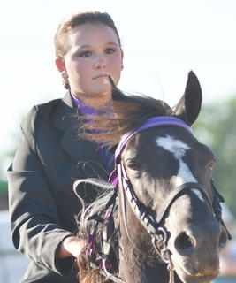 Kelly Moss of Edmonton participates in this year's Tommie Johns Memorial Championship Horse show at the fair on Saturday.