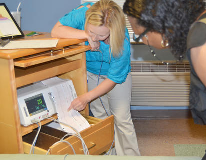 TRH registered nurse Jo Marie Adams explains to Pamela Perry-Cecil of Campbellsville how a fetal monitor works.