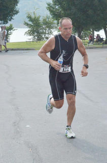 Weldon Riggs of Campbellsville gets a drink of water as he starts the 5K portion of the triathlon.