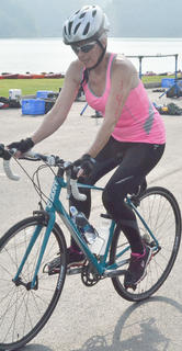 Kate Spieth starts the biking portion of the race.
