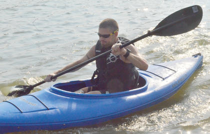 Ryan Clenny paddles his way to shore in the kayak portion of the race.