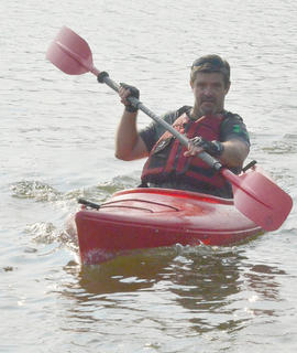Tommy Lewis of Rineyville paddles in the kayak portion of the race.