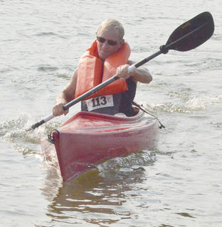Howard Humble makes his way to shore in his kayak.
