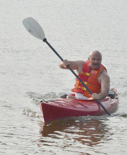 Les Chadwick of Campbellsville paddles to shore as he completes the kayak portion of the race.