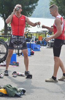 Toby Young, at left, of Columbia, and Nathan Rhodes of Campbellsville fist bump after they complete the biking portion of the race. Young and Rhodes are in training for an IRONMAN race in Louisville later this month. Rhodes, who works for Kentucky State Police, accidentally shot himself in the foot about a year ago.