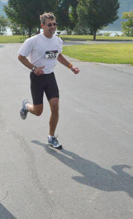 Scott Brewster takes off to complete the last leg of the race, the 5K run.