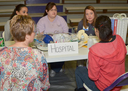 Taylor Regional Hospital employees explain what will happen to student a CHS student while being treated there. From left are registered nurses Jackie Meece, Rachael Dobson and Leah Curry.