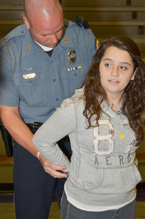Campbellsville Police Officer Andy Warren arrests a CHS student after she commits a crime.