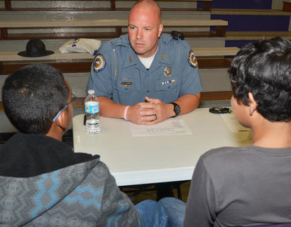 Campbellsville Police Officer Andy Warren asks CHS students why they brought drugs to school.