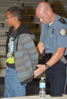 Campbellsville Police Officer Andy Warren arrests a CHS student after he brought drugs to school.